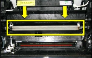 Charge roller is visible when the toner cartridge is removed and drops down from above the cartridge.